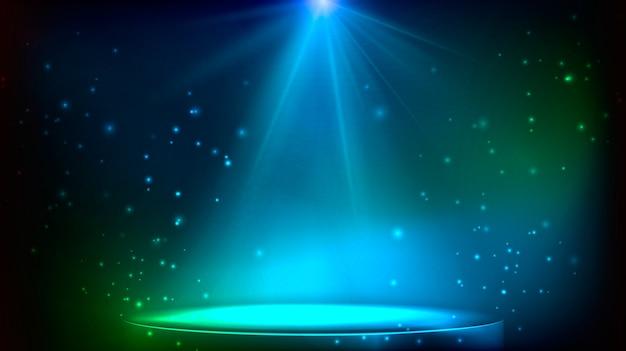 Cena iluminada por um holofote. estágio mágico nas cores azuis e verdes.