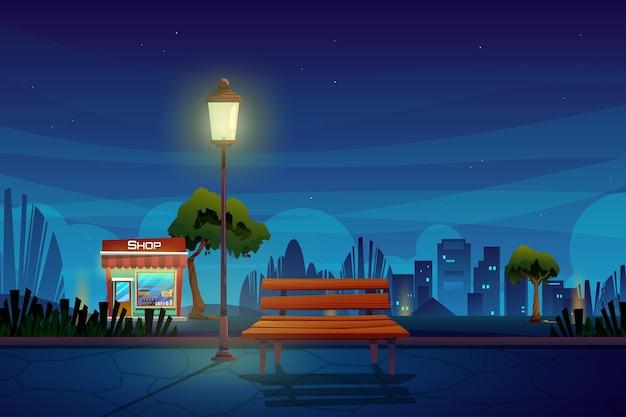 Cena noturna com loja de bebidas no parque dos desenhos animados da cidade com área externa