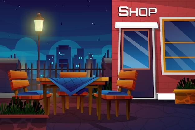 Cena noturna com loja de bebidas no parque dos desenhos animados da cidade com mesa e cadeira