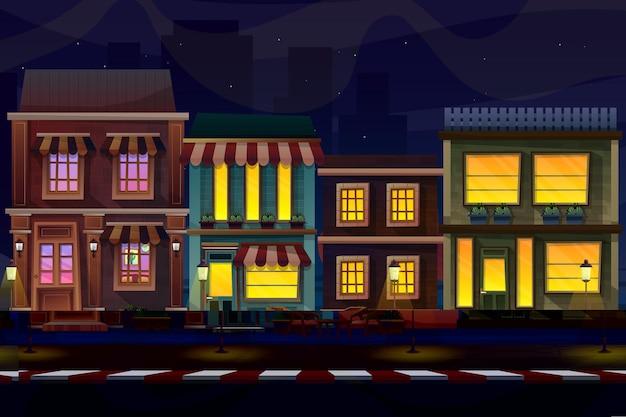 Cena noturna da frente externa da casa com fachada de guarda-sol.