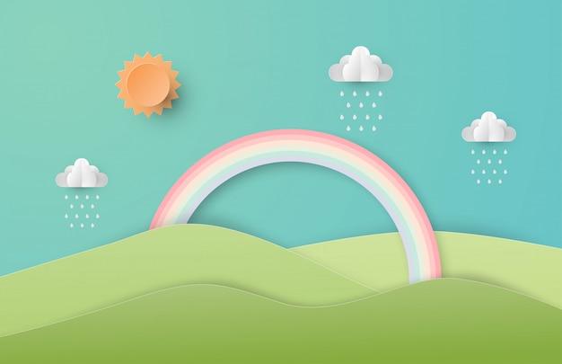 Cenário verde da paisagem da natureza com arco-íris, sol e nuvens no estilo do corte de papel.