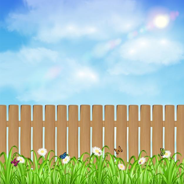 Cerca de madeira com fundo de flor e céu de grama