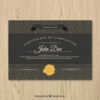 Certificado preto de realização com um selo de ouro