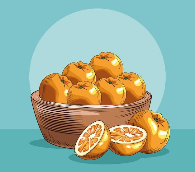 Cesta com frutas frescas de laranjas