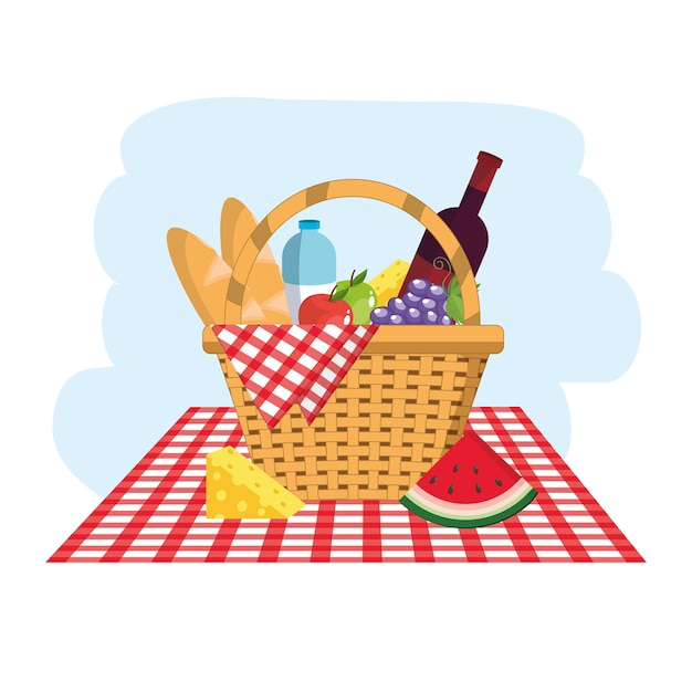 Cesta com pães e garrafas de água na toalha da mesa