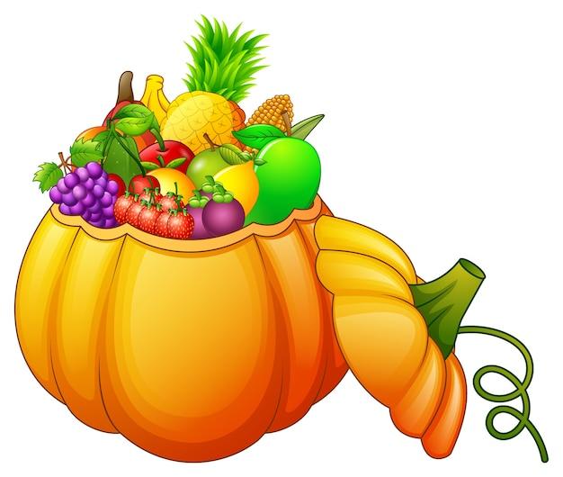 Cesta de abóbora cheia de frutas e legumes