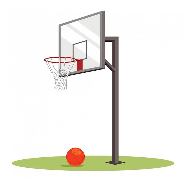 Cesta de basquete e bola no campo verde.