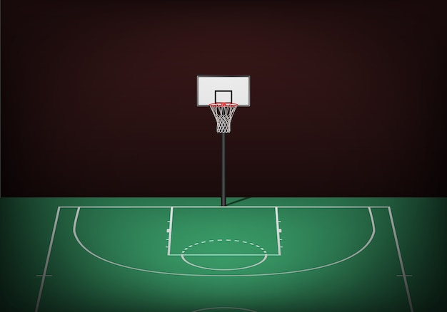 Cesta de basquete na quadra verde vazia.