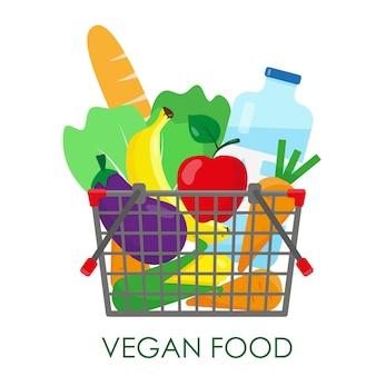 Cesta de compras cheia de produtos vegetarianos frescos.