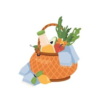 Cesta de piquenique com cobertor de frutas e suco de limonada