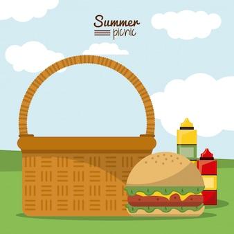 Cesta de piquenique com hambúrguer e molhos