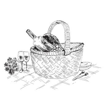 Cesta de piquenique com vinho e copos de desenho