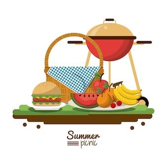 Cesta de piquenique e churrasqueira a carvão e frutas e hambúrguer