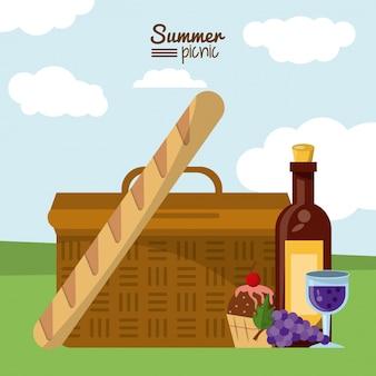 Cesta de piquenique e frango francês e sobremesa e garrafa de vinho
