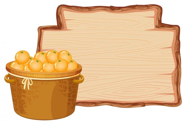 Cesta laranja na placa de madeira