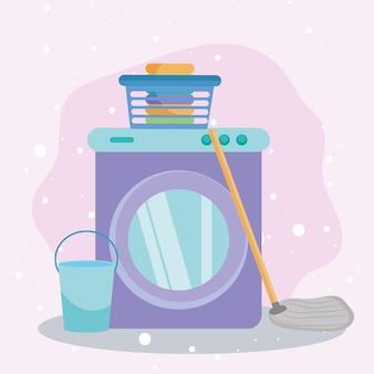 Cesto de roupa suja no balde da máquina de lavar e esfregona