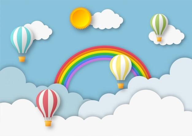 Céu azul. arco-íris com fundo de balão. estilo de arte em papel.