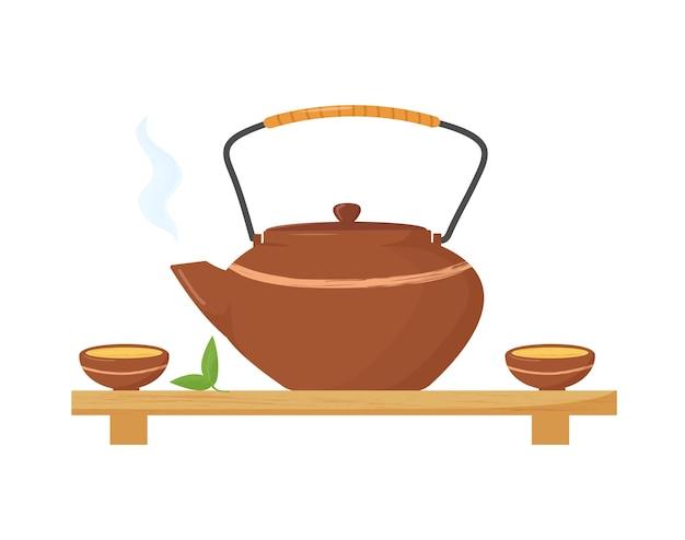 Chaleira quente em estilo asiático com duas xícaras e folhas de chá. cerimônia do chá.