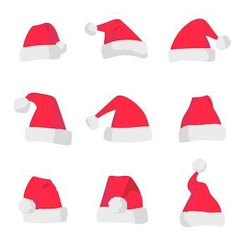 Chapéus vermelhos de papai noel isolados no fundo branco símbolo do feriado de natal
