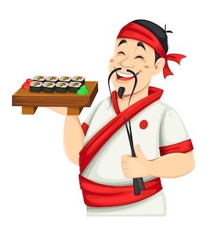 Chef asiático preparando sushi. cozinheiro japonês considerável