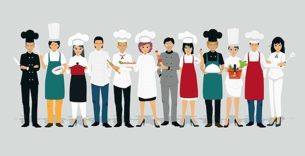 Chef masculinos e femininos uniformizados com fundo cinza