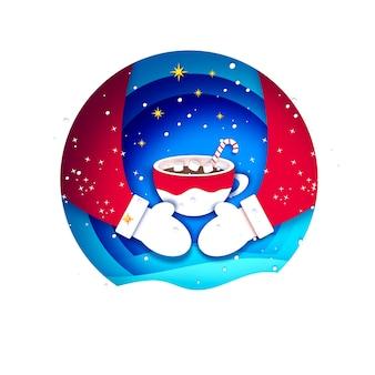 Chocolate quente com marshmallows nos abraços do papai noel. caneca de café de natal com bebida quente de chocolate. taça no vermelho. saudações calorosas. feliz ano novo. feliz natal.