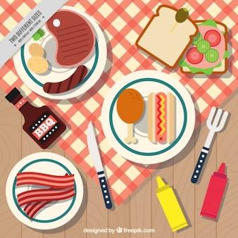 Churrasco e piquenique com pratos de fundo