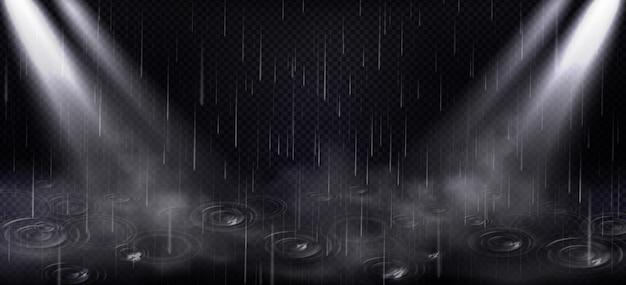 Chuva, ondas de poças e feixes de holofotes, gotas de água caindo e luz