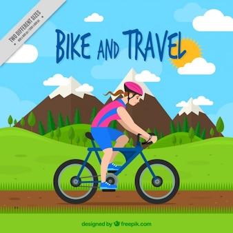 Ciclista da menina no fundo da paisagem