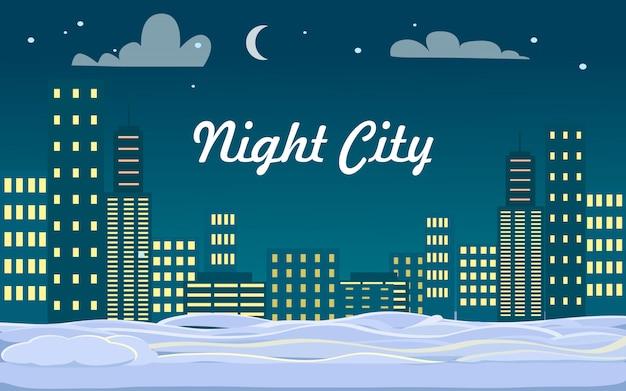 Cidade da noite. edifícios. neve no chão. inverno.