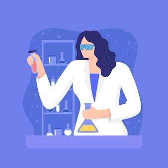 Cientista fêmea que mistura produtos químicos
