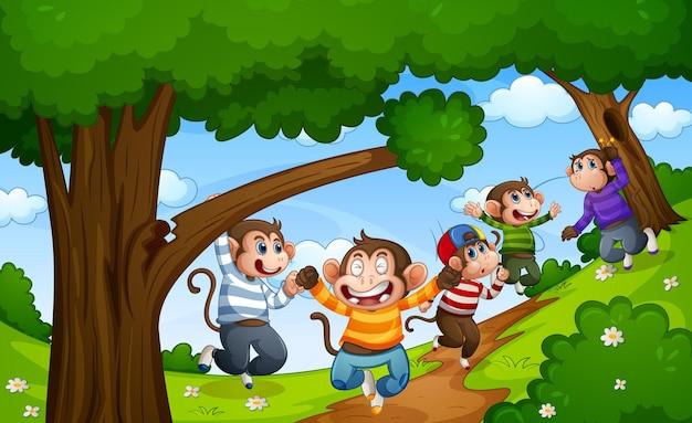 Cinco macaquinhos pulando na cena da floresta