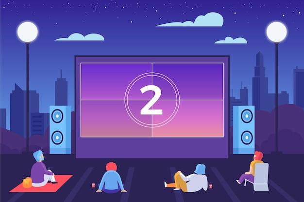 Cinema ao ar livre com gente mantendo distância