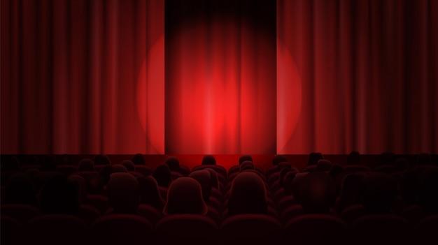 Cinema com cortinas e público.