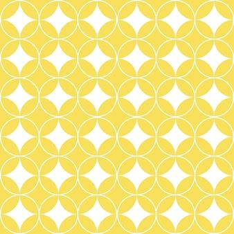 Círculos brancos sobrepostos no padrão geométrico amarelo sem costura.