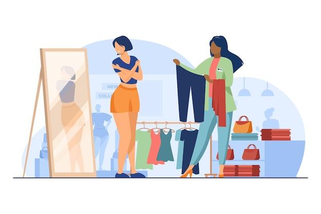 Cliente feminino escolhendo roupas em loja de moda. assistente de loja, vendedor, ilustração em vetor plana consultor. compras, provador