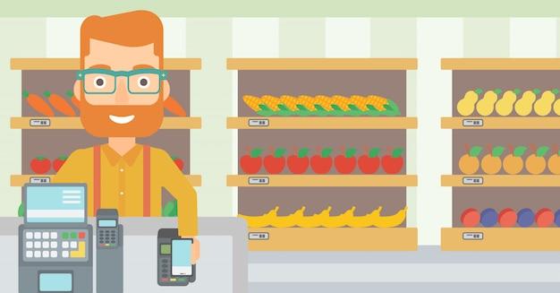 Cliente pagando com seu smartphone usando o terminal.