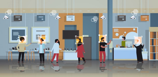 Clientes de raça mista escolhendo dispositivos de identificação digital reconhecimento facial loja de eletrônicos modernos loja interior câmera de segurança sistema de vigilância cctv