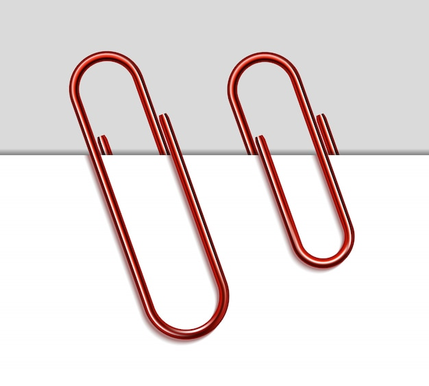 Clipe de papel de metal vermelho e papel em fundo branco.