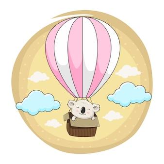 Coala bebê fofo voar com balão de ar