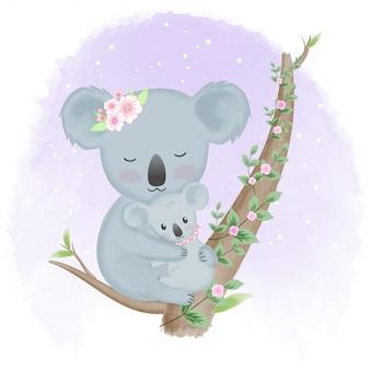 Coala de bebê fofo e mãe na árvore