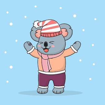 Coala de inverno feliz usando chapéu e syal