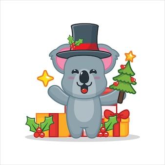 Coala fofo segurando estrela e árvore de natal ilustração fofa dos desenhos animados de natal