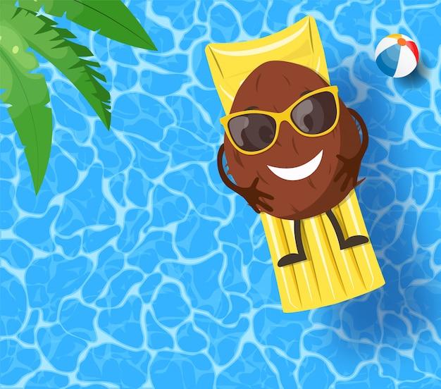 Coco deitado no colchão, sobre a água