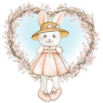 Coelhinha fofa da primavera em aquarela com vestido rosa e coroa de flores com coração