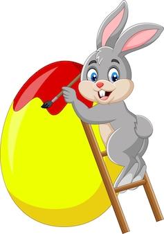 Coelhinho da páscoa, pintando um ovo