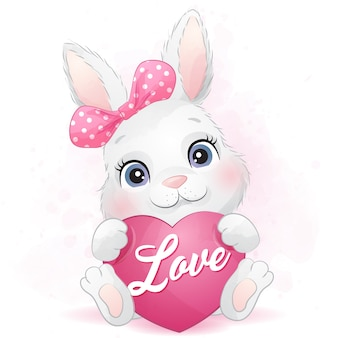Coelhinho fofo, abraçando um coração
