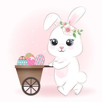 Coelhinho fofo e ovo de páscoa no carrinho