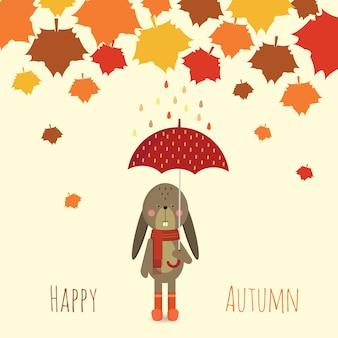 Coelhinho sob o guarda-chuva na temporada de outono