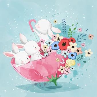 Coelhinhos bonitos no guarda-chuva da primavera